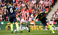 Joe Allen of Stoke city © battles with Laurent Koscielney of Arsenal and Rob Holding of Arsenal. Premier league match, Stoke City v Arsenal at the Bet365 Stadium in Stoke on Trent, Staffs on Saturday 13th May 2017.<br /> pic by Bradley Collyer, Andrew Orchard sports photography.