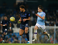 Football - 2019 / 2020 Premier League - Manchester City vs. Everton<br /> <br /> Dominic Calvert-Lewin of Everton breaks through with Eric Garcia of Manchester City in close pursuit, at The Etihad Stadium.<br /> <br /> COLORSPORT/ALAN MARTIN