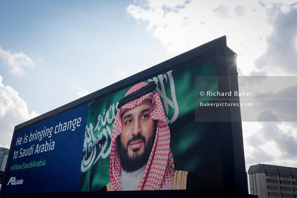 "On the first day of his official 3-day visit to London, the face of Saudi Crown Prince Mohammed bin Salman appears on a large billboard on the A4 West Cromwell Road, on 7th March 2018, in London England. Industry sources said the Saudis could be spending close to £1m on the city-wide campaign, which includes dozens of prime poster sites around London and newspaper ads. ""He is bringing change to Saudi Arabia,"" the ads say, with a large photo of Crown Prince Mohammed bin Salman and the hashtag #ANewSaudiArabia."