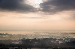 © Licensed to London News Pictures. 22/11/2018. Dorking, UK. Seen from Box Hill near Dorking, the sun peaks through the clouds as mist and frost cover the valley below. Photo credit: Peter Macdiarmid/LNP