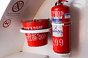 Fire extinguisher and a bucket of sand on board a ship
