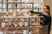 With racks of completed ceramics - FACTORY: the seen and the unseen - an installation, in the form of a ceramics factory, by artist Clare Twomey. It is set up in the Blavatnik Building of the Tate Modern and launches the second year of Tate Exchange which, over 2017 and 2018, will focus on the theme of production.