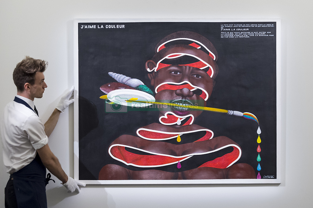 March 29, 2019 - London, UK - A technician presents ''J'aime la couleur'', 2005, by Chéri Samba (Est. GBP 40,000-60,000). Preview of Sotheby's upcoming Modern and Contemporary African Art sale.  Works from artists across the African diaspora will be offered for sale on 2 April. (Credit Image: © Stephen Chung/London News Pictures via ZUMA Wire)