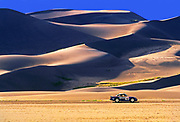 Photo illustration of a 1985 Porsche Safari 959 automobile at the Great Sand Dunes National Park and Preserve, Colorado, American Southwest by Randy Wells