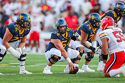 Sep 4, 2021; College Park, Maryland, USA; West Virginia Mountaineers offensive lineman Zach Frazier (54) yells from over center during the fourth quarter against the Maryland Terrapins at Capital One Field at Maryland Stadium. Mandatory Credit: Ben Queen-USA TODAY Sports