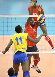 Hope Musaniwabo of Rwanda spikes against Pauline Wafula of Kenya during their U23 Africa Nations Championship at Safaricom Stadium Stadium in Nairobi on October 27, 2016. Kenya won 3-1. Photo/Fredrick Onyango/www.pic-centre.com (KEN)