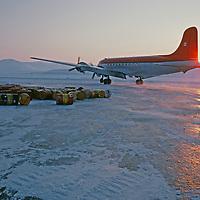 A Wheeled DC-4 airplane taxis on frozen Lake Hazen.