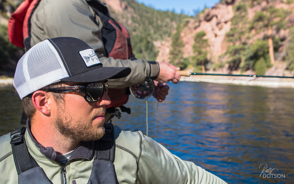 Utah Fish Chasers/Spinner Fall guide Jordan watches out for any sign of fishy activity on the edges.