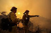 Firefighters keep watch a wildfire near Placenta Canyon Road in Santa Clarita, Calif., Sunday, July 24, 2016.(AP Photo/Ringo H.W. Chiu)