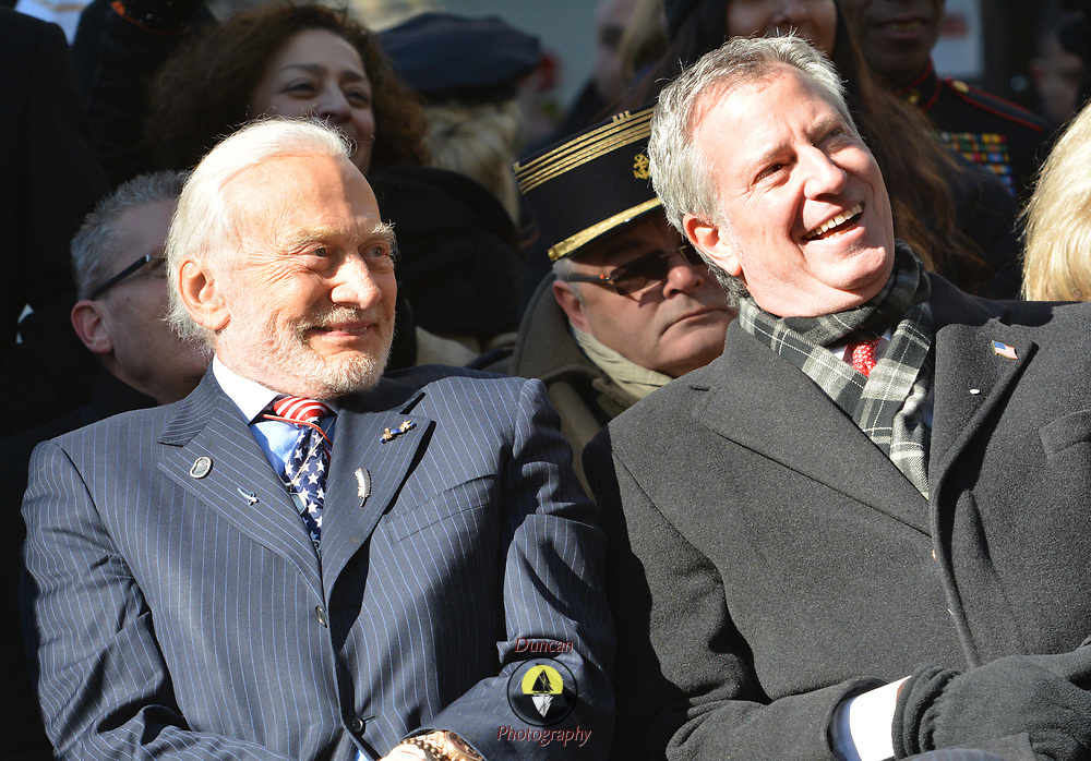 NEW YORK -- U.S. Army Col. (Ret) and astronaut Buzz Aldrin, left, sits with New York Mayor Bill de Blasio at the 2017 New York City Veterans Day Parade ceremony, honoring the service of all our nation's veterans. <br /> Aldrin served as parade grand marshal and, in his speech, advocated for space travel to Mars. <br /> #USNavy, #NavyInNYC, #VeteransDay, #USNavy, #VeteransDay #NeverForget (U.S. Navy photo by Chief Mass Communication Specialist Roger S. Duncan/ Released)