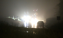 Petersfield Hampshire Friday 16th September 2016<br /> <br /> Fatal collision involving single vehicle on the A3 near Petersfield<br /> <br /> <br /> A Woman has died after her. Vehicle  flipped as flash floods hit the South.<br /> <br /> Police are continuing to investigate a single vehicle fatal collision on the A3 Southbound near the Petersfield this morning. Despite the efforts of the emergency services including Fire and a Hart Team the person was unable to be saved was certified dead at the scene. Specialist officers from the Hampshire Road Death team along with collision scene investigation officers have spent most of the night under torch light being lashed by flash flooding to gather evidence from scene. It is believed that the vehicle crossed over and flipped. Emergency services where called to the scene just before midnight. Hard traffic diversion are in place and motorists are requested to follow  the black diamond sign and us the A32 from the A272 as an alternative route. A Spokesman for Highways England has advised that the road is likely to stay closed until at least 7am. @UKNIP