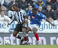 Photo. Andrew Unwin,  Digitalsport<br /> Newcastle United v Portsmouth, Barclaycard Premier League, St James' Park, Newcastle upon Tyne 25/10/2003.<br /> Newcastle's Titus Bramble (l) holds off Portsmouth's Yakuba Ayegbeni (r).
