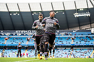 Crystal Palace players  during the warm up before the  Premier League match between Manchester City and Crystal Palace at the Etihad Stadium, Manchester, England on 23 September 2017. Photo by Sebastian Frej.