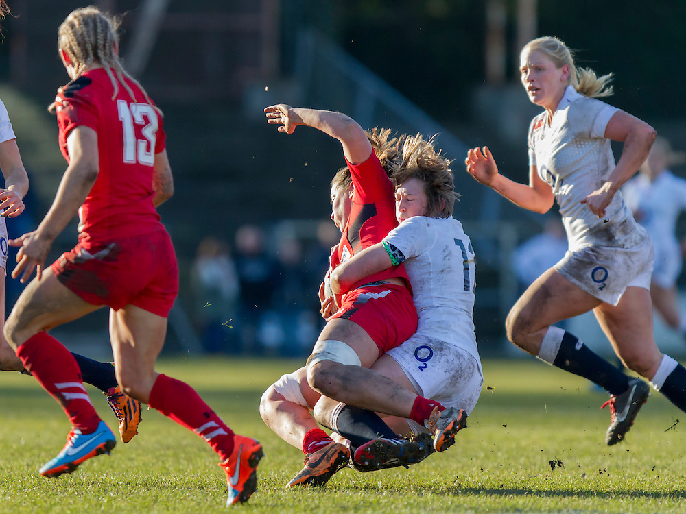 Meg Goddard tackles Sionead Harries, Wales Women v England Women in Women's 6 Nations Match at St Helens, Swansea, Wales, on 8th February 2015