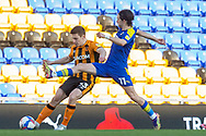 AFC Wimbledon midfielder Ethan Chislett (11) battles with Hull City midfielder Greg Docherty (33) during the EFL Sky Bet League 1 match between AFC Wimbledon and Hull City at Plough Lane, London, United Kingdom on 27 February 2021.