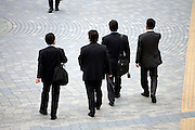 group of businessmen meeting up with an other businessman