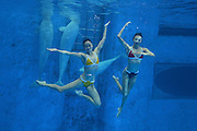 CHENGDU, CHINA - AUGUST 18: (CHINA OUT) <br /> <br /> Jiang Wenwen and Jiang Tingting, the twin Chinese water ballet dancers, have their wedding photographs under water at Haichang Polar Ocean World on August 18, 2013 in Chengdu, Sichuan Province of China.<br /> ©exclusivepix