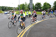 7-7-2012: 7.30am and Taoiseach Enda Kenny  (on left) leads over 10,000 cyclists out of Killarney on the annual Ring of Kerry charity cycle on Saturday. The route of 120 miles takes in the towns of Killorglin, Cahersiveen, Waterville, Sneem, Kenmare and finishes back in Killarney..Picture by Don MacMonagle