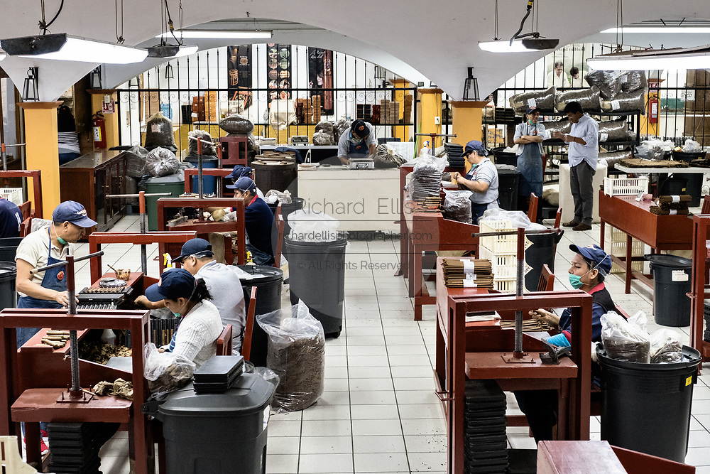 The cigar rolling area where workers hand roll fine cigars from tobacco leaf at the Santa Clara cigar factory in San Andres Tuxtlas, Veracruz, Mexico. The factory follows traditional hand rolling using the same process since 1967 and is considered by aficionados as some of the finest cigars in the world.