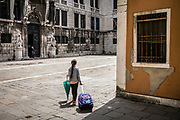 Venice, Italy, 14 may 2018, Girl walking on a square