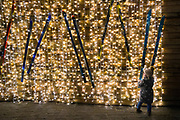 Little girl plays with a ski at a christmas market, ghent, belgium, 12.12.2015