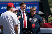 MyPillow owner, Mike Lindell, an outspoken booster of the president poses for a photo before President Donald Trump's campaign rally at North Star Aviation in Mankato, Minnesota on Monday, Aug. 17, 2020.