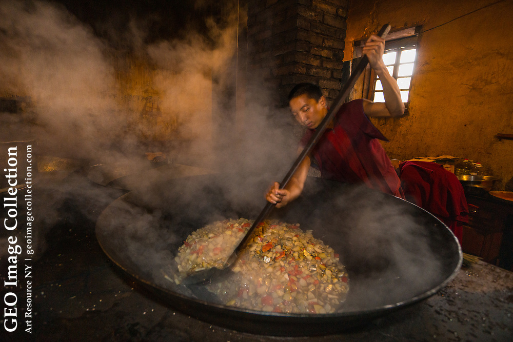 Stir fry for 300 at Songzanlin Monastery, Benzilan, Yunnan, China: Mushroom, tomatoes, carrots and potatoes served atop rice will be the main meal of the day after monks morning meditation.