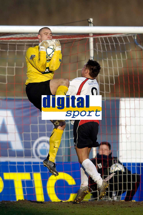 Photo: Jed Wee.<br /> Clyde v Glasgow Celtic. Scottish Cup. 08/01/2006.<br /> <br /> Celtic goalkeeper Artur Boruc (L) claims a catch before Clyde's Alex Williams can get to the ball.