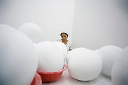 Assistant Liu Guxiang works with egg-shaped objects in Lin Tianmiao's studio in Songzhouang Village, east of Beijing.