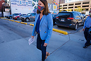 13 OCTOBER 2020 - DES MOINES, IOWA: THERESA GREENFIELD, the Democratic candidate for the US Senate from Iowa, walks into the Polk County Auditor's office to drop off her early ballot. Greenfield, the Democratic candidate for US Senate, dropped off her completed ballot at the Polk County Auditor's Office in Des Moines. Greenfield is running against incumbent US Senator Joni Ernst, a Republican. Greenfields holds a slight lead over Ernst in recent polling.        PHOTO BY JACK KURTZ