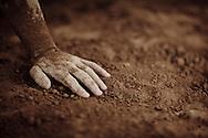 Hand of a Kushti wrestler in the dirt, Varanasi, India