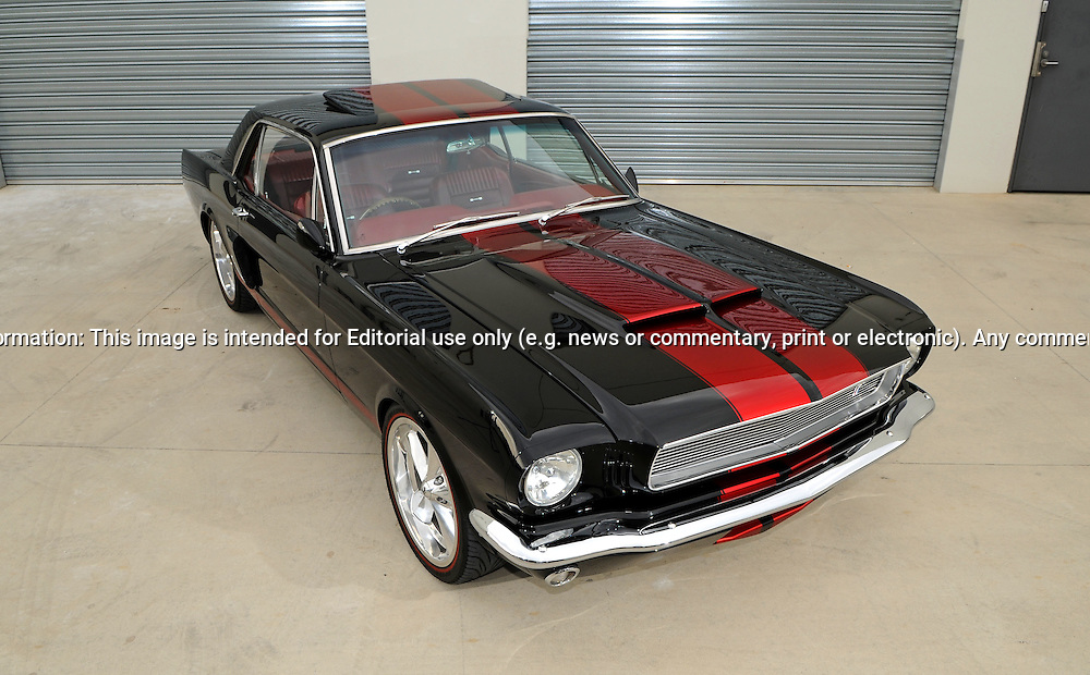 1964 Ford Mustang Coupe - PPG Black with PPG Candy Red Stripes.Port Melbourne, Melbourne, Victoria.9th of April 2011.(C) Joel Strickland Photographics.Use information: This image is intended for Editorial use only (e.g. news or commentary, print or electronic). Any commercial or promotional use requires additional clearance.