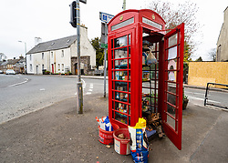Community Larder in old telephone box used during Coronavirus lockdown in village of Muthill ,  Perth and Kinross, Perthshire, Scotland, UK