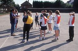 Games teacher teaching netball to secondary school pupils,
