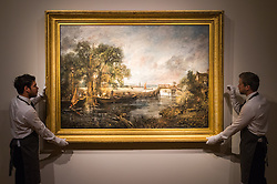 """Christie's, St James, London. Gallery technicians straighten the painting as Christie's in London announce the sale of a work of genius by John Constable, the full scale six-foot """"sketch"""" for """"View on the Stour near Dedham"""" painted between 1821 and 1822, which is expected to fetch between £18-22 million at auction."""