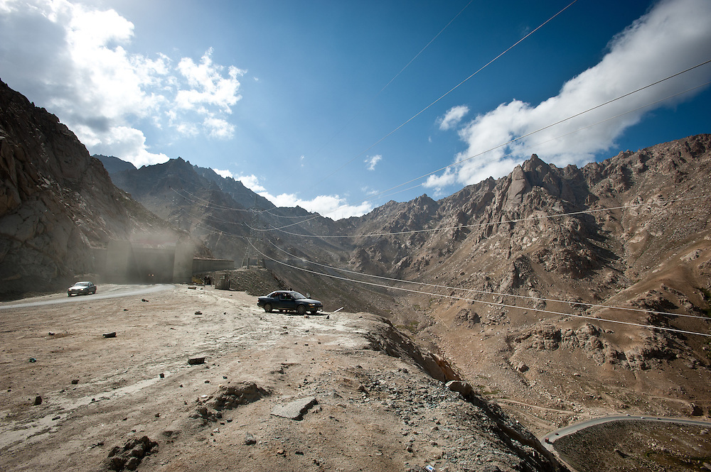 A car parked on an overlook at the exit of the Salang Tunnel, constructed by the Soviet Union and once the highest altitude mountain tunnel in the world, north Kabul, Afghanistan.