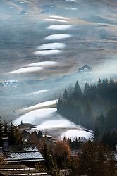 © Licensed to London News Pictures. 09/12/2016. La Clusaz, Haute Savoie, France. Patches of artificial snow made by snow-canons are seen on a piste in the ski resort of La Clusaz on the day before the resort opens. There is a serious lack of snow in the French Alps before most ski resorts open on the 10th December 2016. There was a good snow fall in the first week of November but this snow has since melted. Photo credit: Graham M. Lawrence/LNP