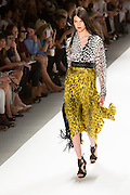 Dress with a yellow and black jungle print, Fortuny-style pleated skirt and a black and white jungle print top. By Carlos Miele at the Spring 2013 Mercedes-Benz Fashion Week in New York.