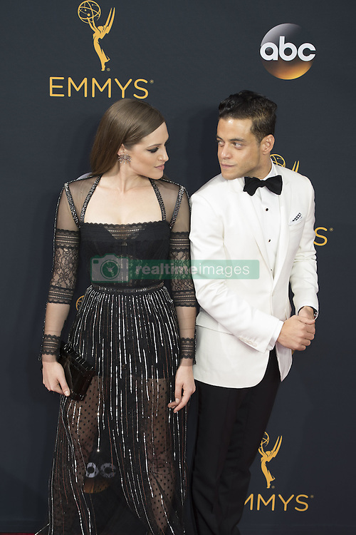 September 18, 2016 - Los Angeles, California, U.S. - CARLY CHAIKIN, left, and RAMI MALEK arrive for the 68th Annual Primetime Emmy Awards, held at the Nokia Theatre. (Credit Image: © Kevin Sullivan via ZUMA Wire)