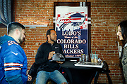 SHOT 12/10/17 12:26:57 PM - Former Buffalo Bills wide receiver and Hall of Fame player Andre Reed signs autographs and meets with fans at LoDo's Bar and Grill in Denver, Co. as the Buffalo Bills played the Indianapolis Colts that Sunday. Reed played wide receiver in the National Football League for 16 seasons, 15 with the Buffalo Bills and one with the Washington Redskins. (Photo by Marc Piscotty / © 2017)