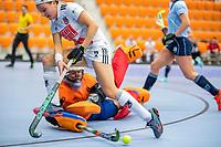 ROTTERDAM - Joy Haarman (Adam) met keeper Karlijn Adank (Laren)  dames Amsterdam-Laren  ,hoofdklasse competitie  zaalhockey.   COPYRIGHT  KOEN SUYK