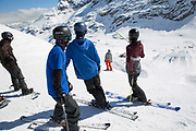 Great British freestyle ski team watch Katie Ormerod drop into the slopestyle course on 05th May 2017 in Corvatsch, Switzerland. Piz Corvatsch is a mountain in the Bernina Range of the Alps, overlooking Lake Sils and Lake Silvaplana in the Engadin region of the canton of Graubünden.
