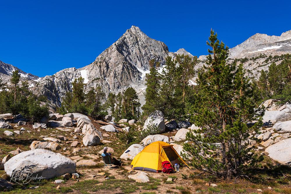 Backpacker and tent under the Sierra crest, John Muir Wilderness, Sierra Nevada Mountains, California USA