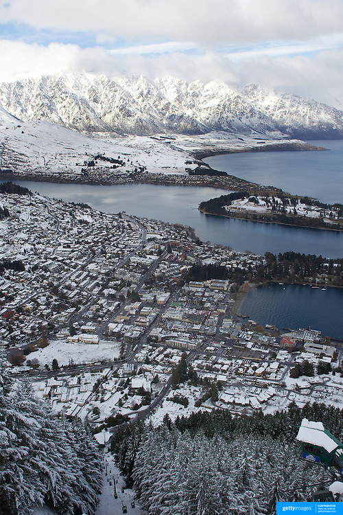 A view of Queenstown, New Zealand with the snow covered Remarkables mountain range providing a stunning backdrop after winter snowfalls..Queenstown is nestled on the shores of the crystal clear waters of Lake Wakatipu in the Central Otago region of the South Island of New Zealand..Queenstown is New Zealand's premier tourist destination providing an abundance of year round outdoor activities for both young and old. Queenstown, Central Otago, South Island, New Zealand. 10th July 2011. Photo Tim Clayton..