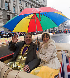 © London News Pictures. 01/01/2012. London, UK. Russell Grant and his dance partner Flavia Cacace from Strictly Come Dancing aboard the Beauford Belle taking part in the 2012 New Years Parade in London on January 1st, 2012. Photo credit : Ben Cawthra/LNP
