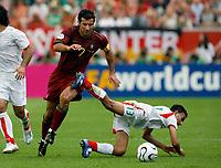 Photo: Glyn Thomas.<br />Portugal v Iran. Group D, FIFA World Cup 2006. 17/06/2006.<br /> Portugal's Luis Figo (L) and Iran's Hossein Kaabi.