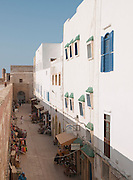 Shops and hotels sit behind the old fortified wall at Essaouira medina in Morocco
