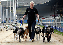 ©London News pictures. 17.02.2011. Iwan Thomas walks with six retired greyhounds along Wimbledon Racetrack.  Iwan Thomas joins the Retired Greyhound Trust (RGT) today (Thurs) at Wimbledon Stadium to highlight the plight of thousands of retired dogs needing homes. The trust currently has 1,000 dogs needing homes and a further 4,000 expected this year. The dogs only need two 20min walks a day Greyhound UK has teamed up with the RGT as its charity for the for the year. Picture Credit should read Stephen Simpson/LNP