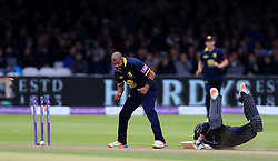 Surrey's Tom Curran fails to make the ground in his dive as he is run out for 4 as Warwickshire's Jeetan Patel celebrates during Royal London One Day Cup Final at Lord's, London.