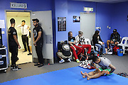 """Blue locker room preparation<br /><br />MMA. Mixed Martial Arts """"Tigers of Asia"""" cage fighting competition. Top professional male and female fighters from across Asia, Russia, Australia, Malaysia, Japan and the Philippines come together to fight. This tournament takes place in front of a ten thousand strong crowd of supporters in Pelaing Stadium. Kuala Lumpur, Malaysia. October 2015"""